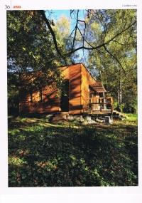 NAPSALI O NÁS: Elegantní dřevěná chata stojí v les